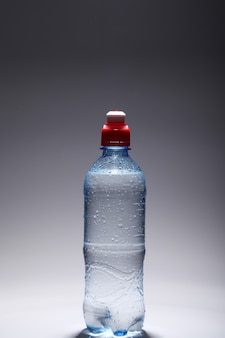 Plastic bottle of fresh and cold water