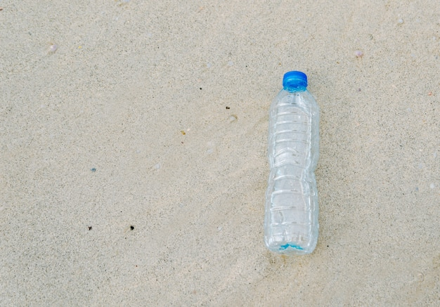 Plastic bottle garbage on the beach human waste dumping