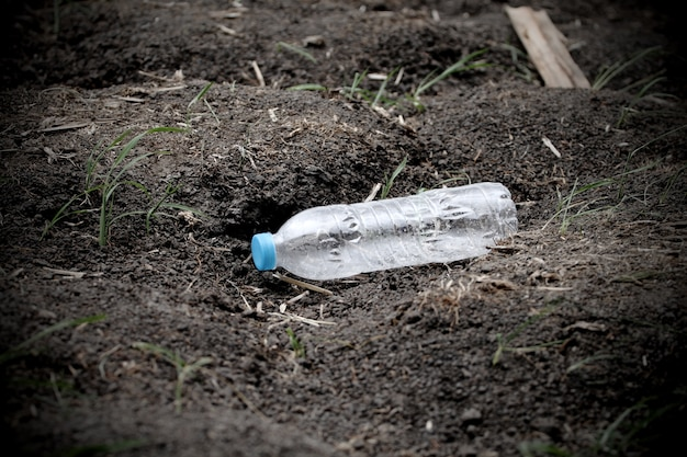 Plastic bottle garbage on the soil ground  that can recycle
