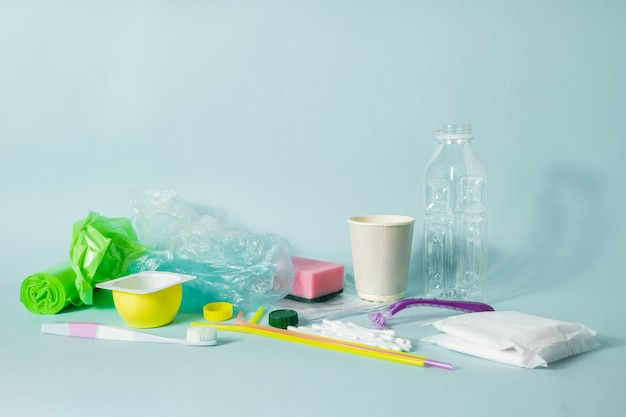 Plastic bottle, hygiene items and plastic package depicting ecological