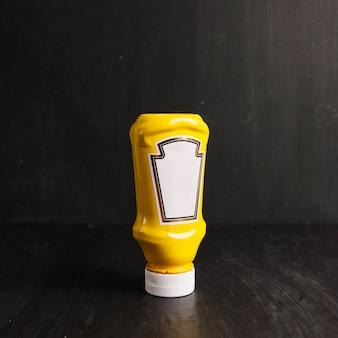 Plastic bottle of mustard
