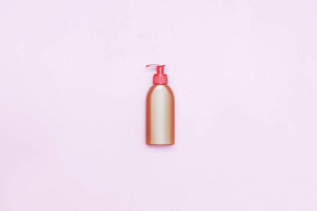 Plastic bottle pomp with cosmetic liquid, soap or shampoo, gel.