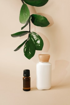 Plastic bottle with body care cream and a glass bottle with oil