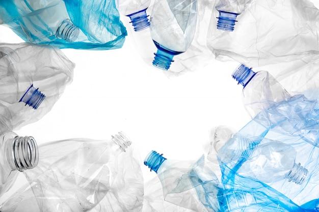 Plastic bottles and bags border frame