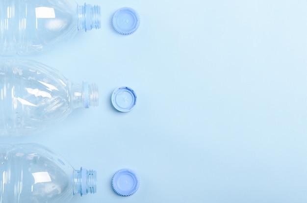 Plastic bottles on a blue background.