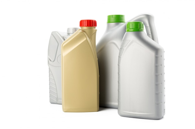 Plastic bottles from automobile oils isolated on white