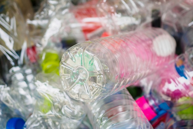Plastic bottles in recycle trash station close up