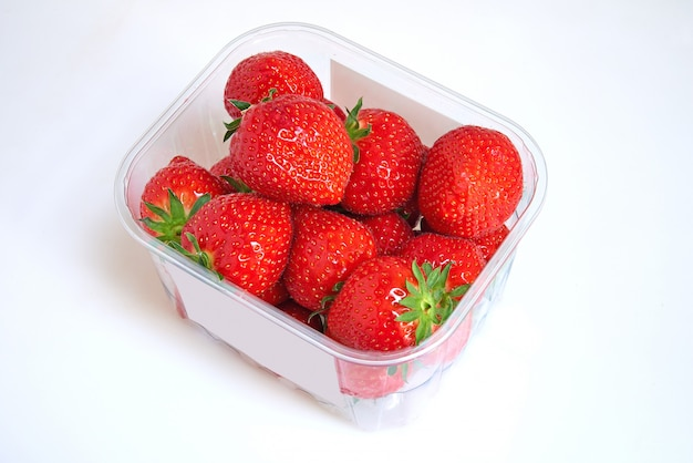 Plastic box of strawberries and white label