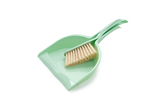 Plastic broom with dustpan green color on white background
