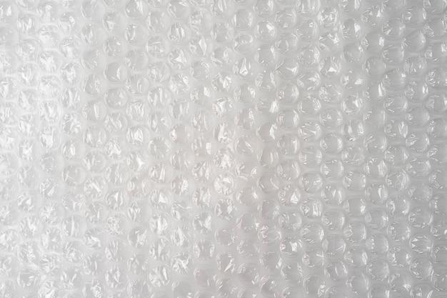 プラスチックバブルラップテクスチャ背景、壁紙の不均一な稲妻