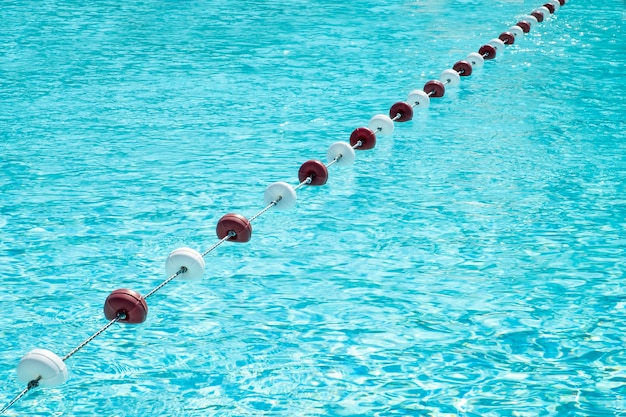 Plastic buoys to limit swimming in the aqua park. summer time