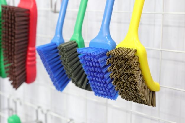 Plastic cleaning brushes in supermarket hanger