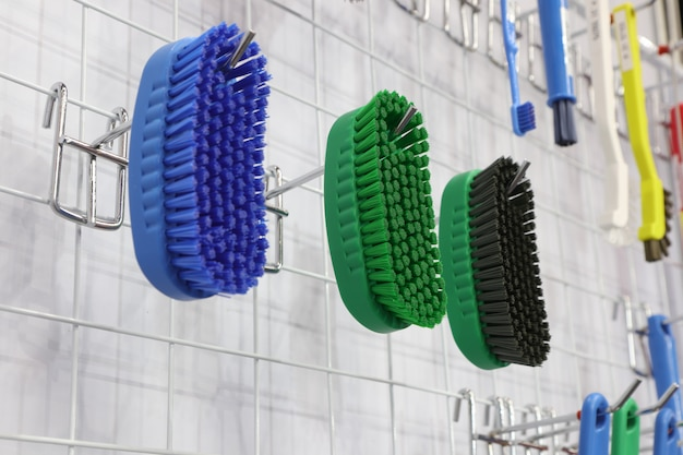 Plastic cleaning brushes in supermarket hanger ;