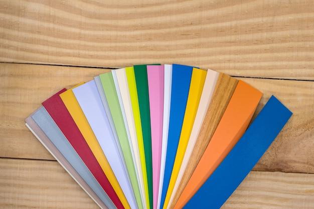 Plastic coloured sampler for furniture on wooden desk