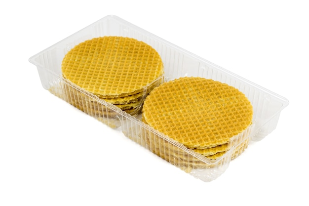 Plastic container with round wafers isolated on a white background. fresh homemade cakes.