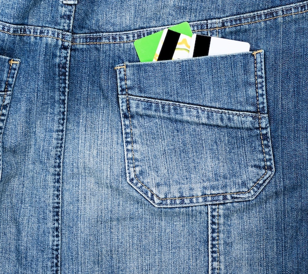 Plastic credit card in the back pocket of the jeans