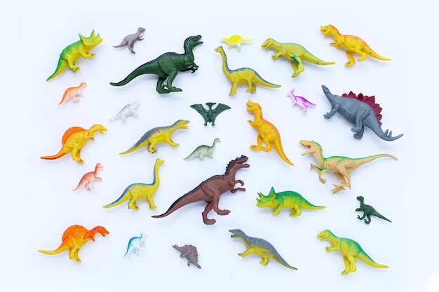 Plastic dinosaur toys on white surface