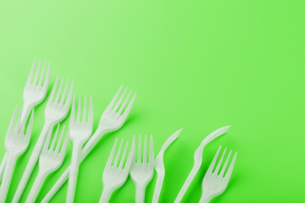 Plastic dishes on a green surface