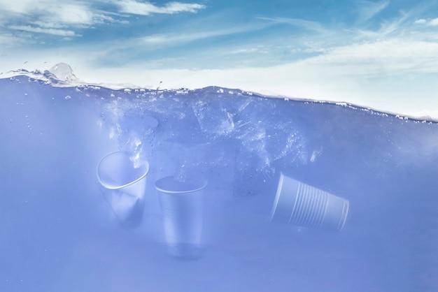 The plastic float underwater in ocean, waterline, environment water pollution ecosystem