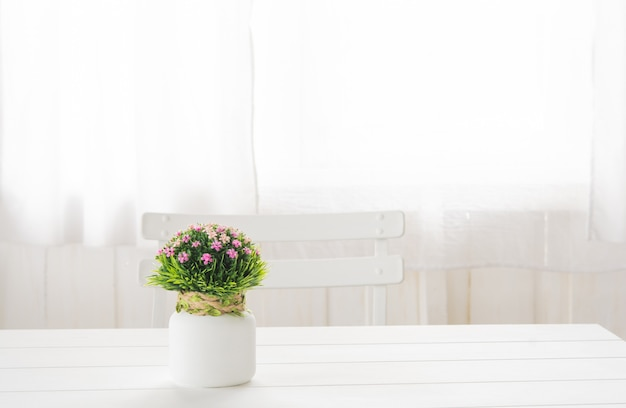 Plastic flower bouquet in a bottle