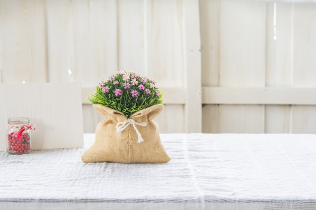 Plastic flower bouquet in a sack bag