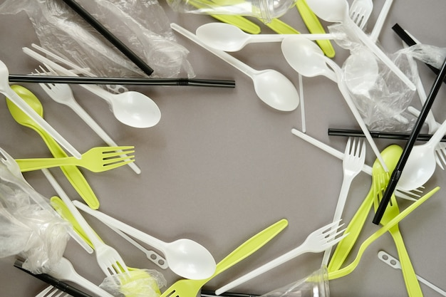 Plastic forks spoons space for text