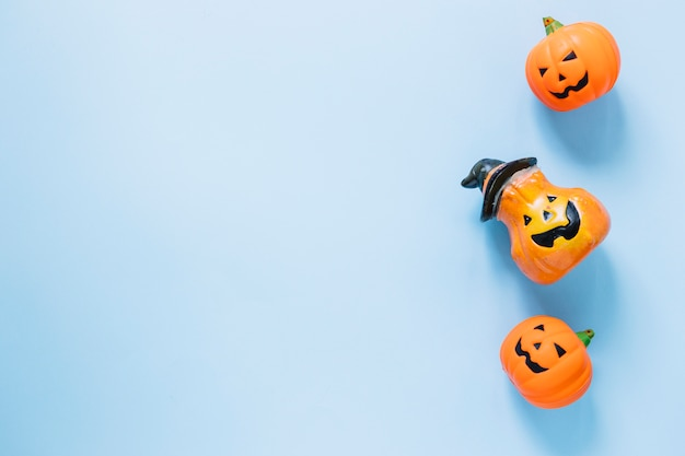 Plastic halloween pumpkins laid in line