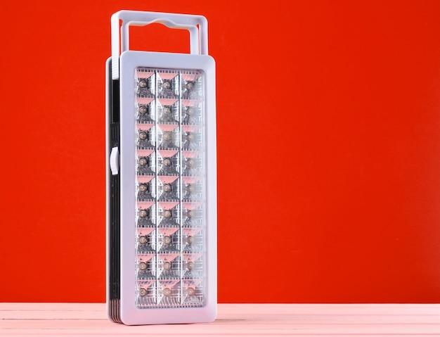 Plastic led flashlights on red background