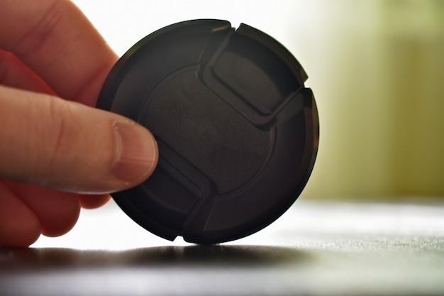 Plastic lid in hand