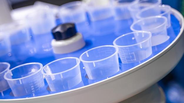 Plastic measuring cup in laboratory