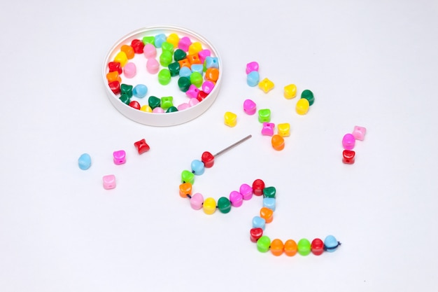 Plastic multicolored beads. homemade game for children development concept.