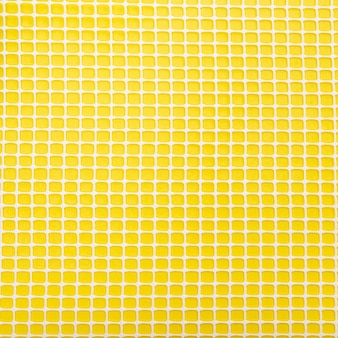 Plastic net on yellow background
