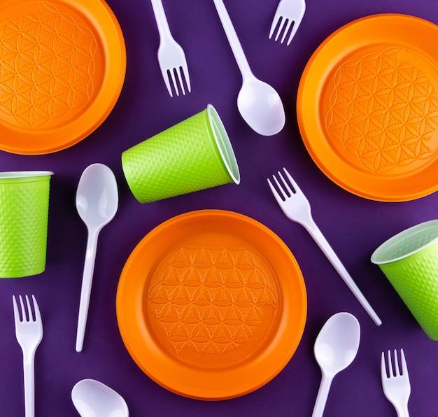 Plastic orange green waste collection on purple