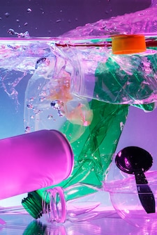 Plastic and other waste polluting the ocean neon background