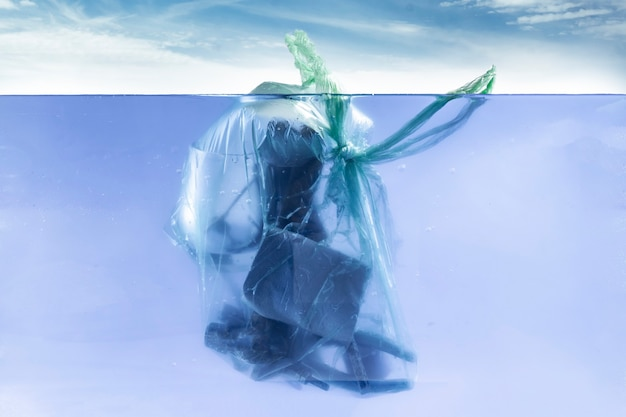 The plastic package with waste garbage  inside float in the ocean water underwater line, dump environment problem