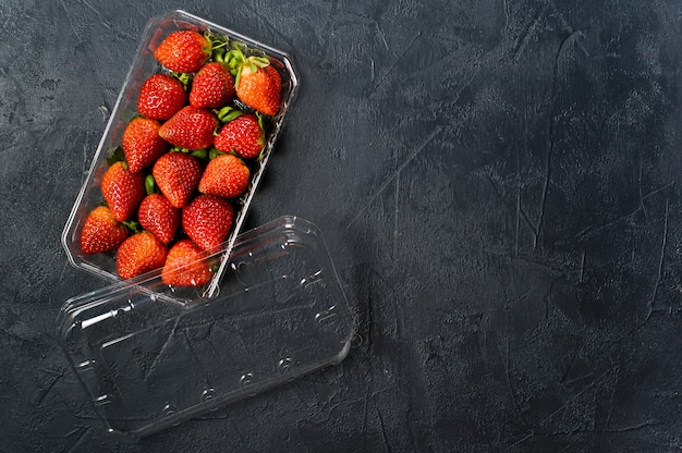 Plastic packaging of strawberries.