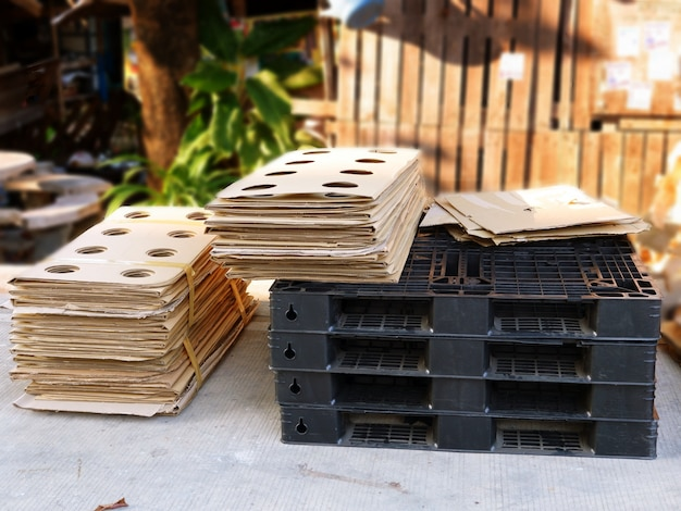 Plastic pallet and stacked cardboard