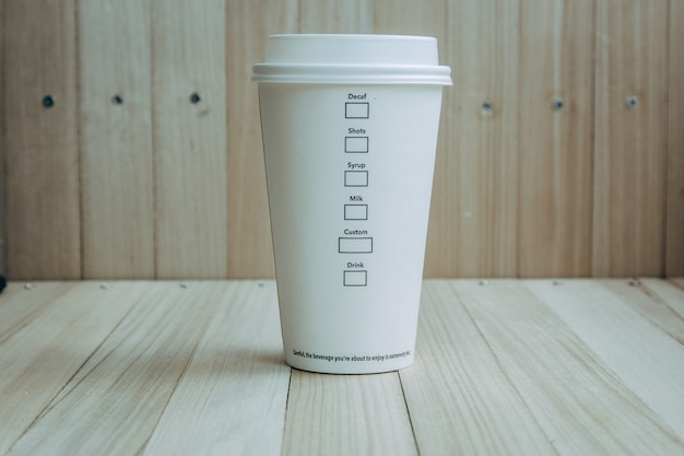 Plastic and paper coffee cup