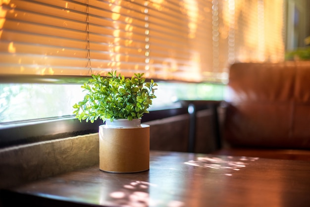 Plastic plant on wooden table for decoration at the cafe