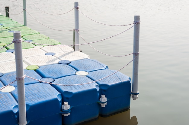 Plastic pontoon with the rope fence.