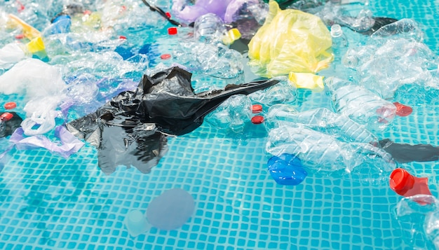 Plastic recycling, pollution and environmental concept - environmental problem of plastic rubbish pollution in ocean