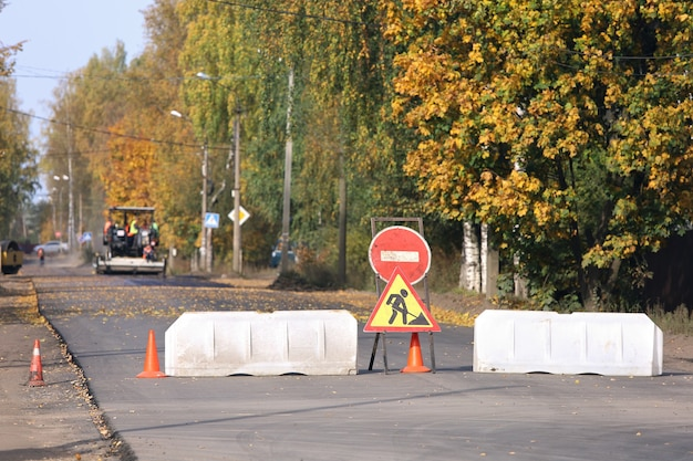 Plastic road barriers and repair work signs block access