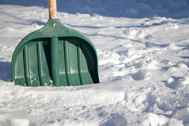 Plastic shovel for snow removal. winter season. cold weather