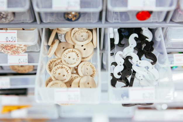 Plastic storage container with wooden buttons for decorative purpose