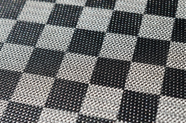 Plastic texture in the form of a very small cloth binding, painted in black and gray in the style of a chessboard