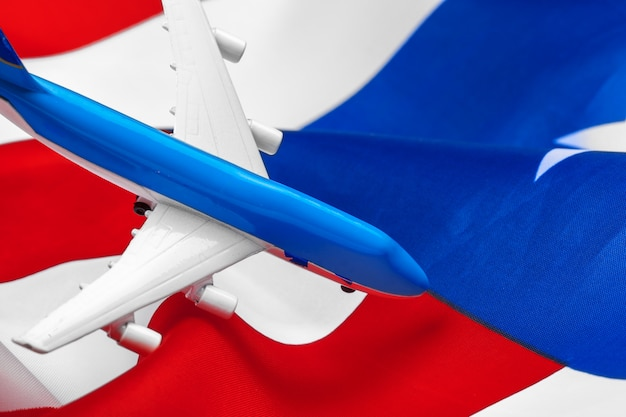 Plastic toy jet plane and flag of usa.