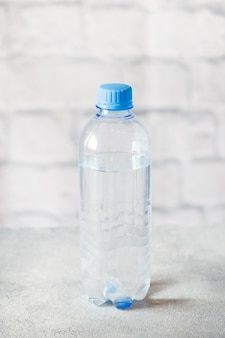 Plastic transparent water bottle on grey surface