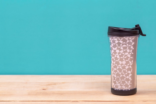 Plastic tumbler glasses or thermos travel cup