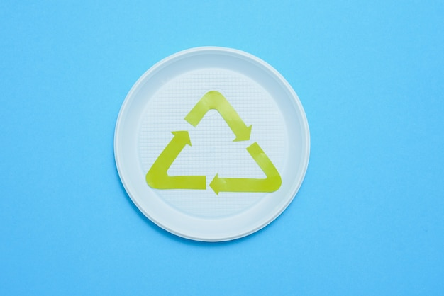 Plastic waste collection on blue background