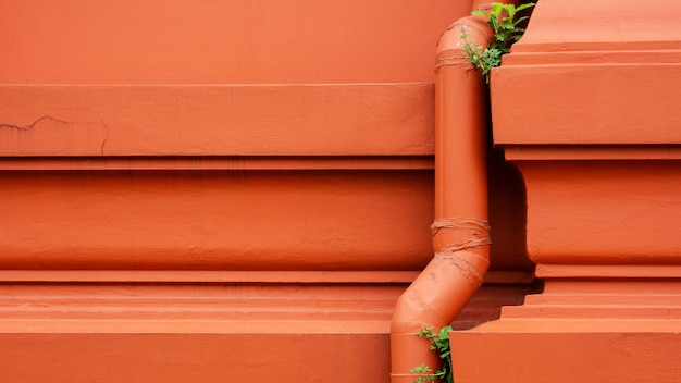 Plastic water piping system installed at the orange concrete building